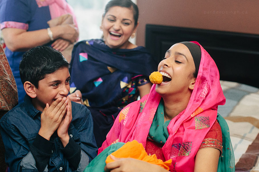 Punjabi Wedding Bride Eating Ladoo